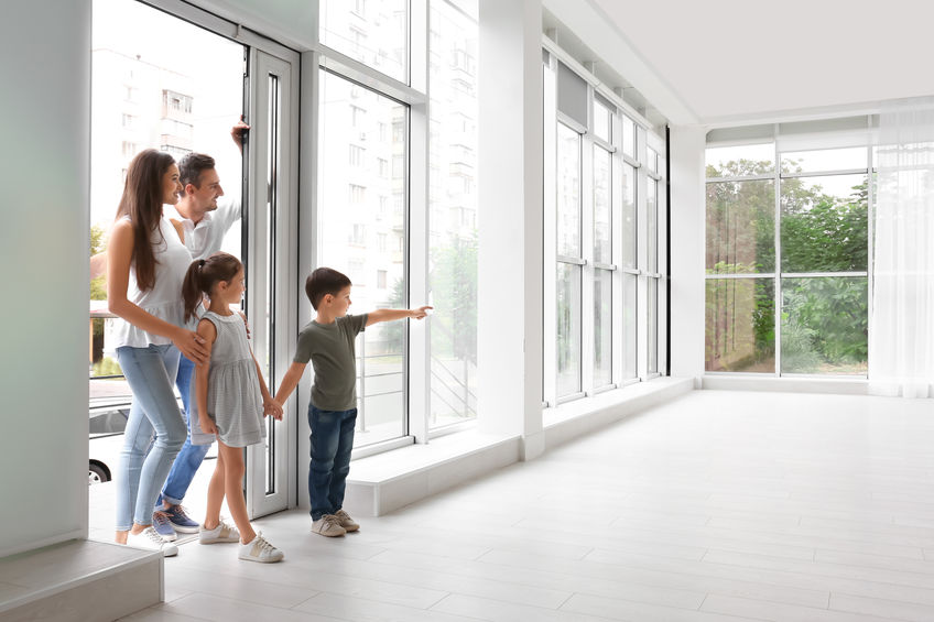 Family entering a rental home
